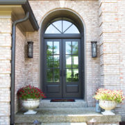 × After – With A Half Round Transom Over Eight Foot Marvin Paneled Swinging French Doors, This Entryway Has Improved Scale And Better Matches The Look Of The Entire House In Color And Style.