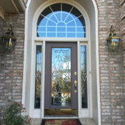 Before – With A Transom That Is Busy And A Bit Out Of Scale With The Standard Sized Door, This Entryway Doesn't Offer Much To Enhance The Curb Appeal Of The Home.