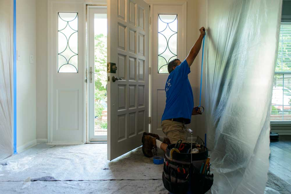 Our team takes the time to cover surfaces in your home with plastic sheeting to keep the work area contained