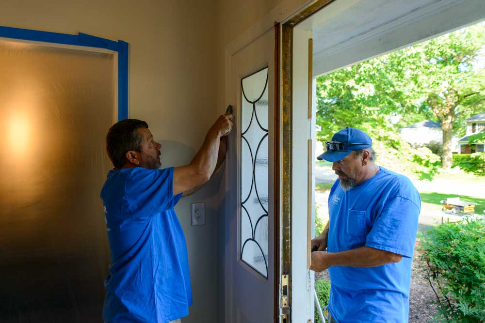 Before installing your new product, the old door and frame are carefully removed.