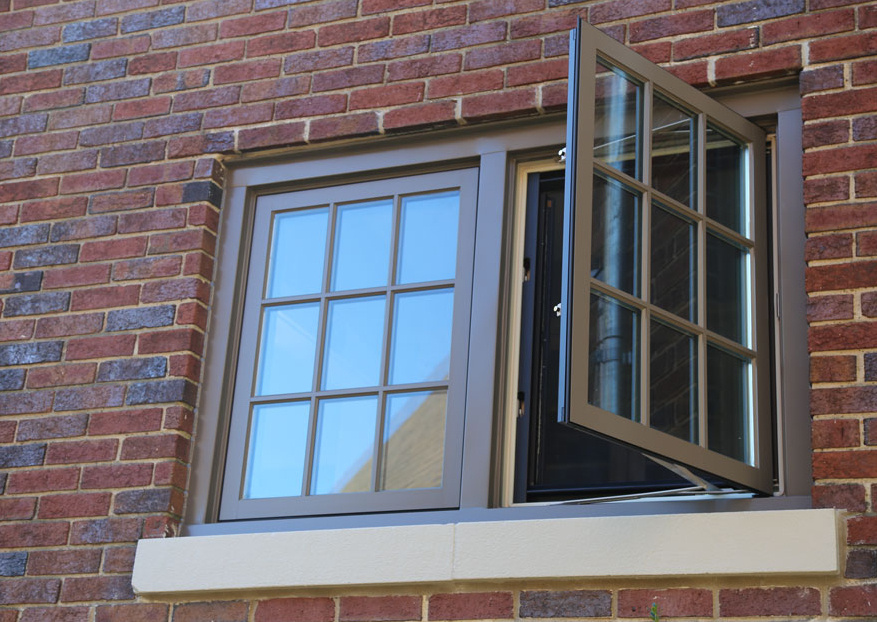divided lites casement windows in a brick house