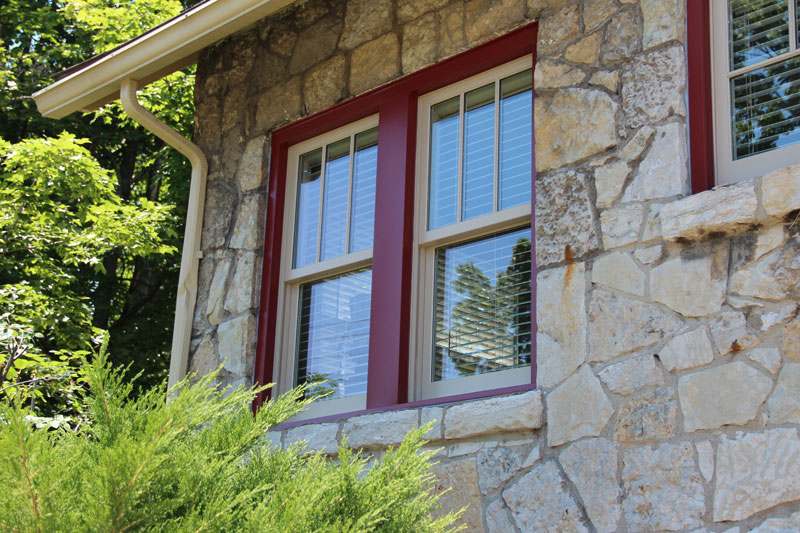 two double hung windows in a stone house
