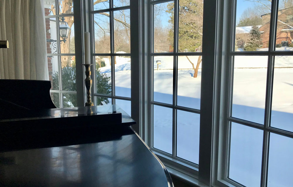 image of clear new bow window with snow outside