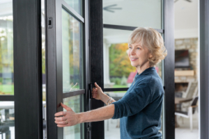 woman opening a bi-fold door