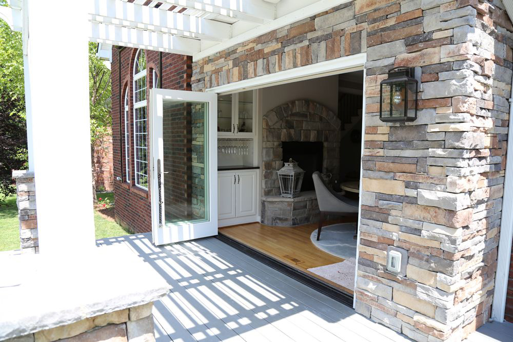 biparting folding door open with dining room inside