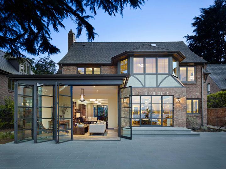 Arcadia custom bi-fold steel doors in a tudor style house