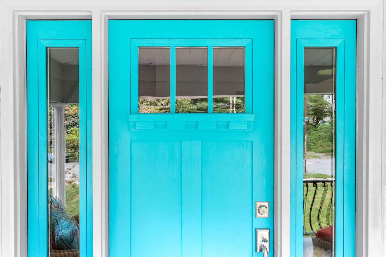 bright blue entry door with sidelites