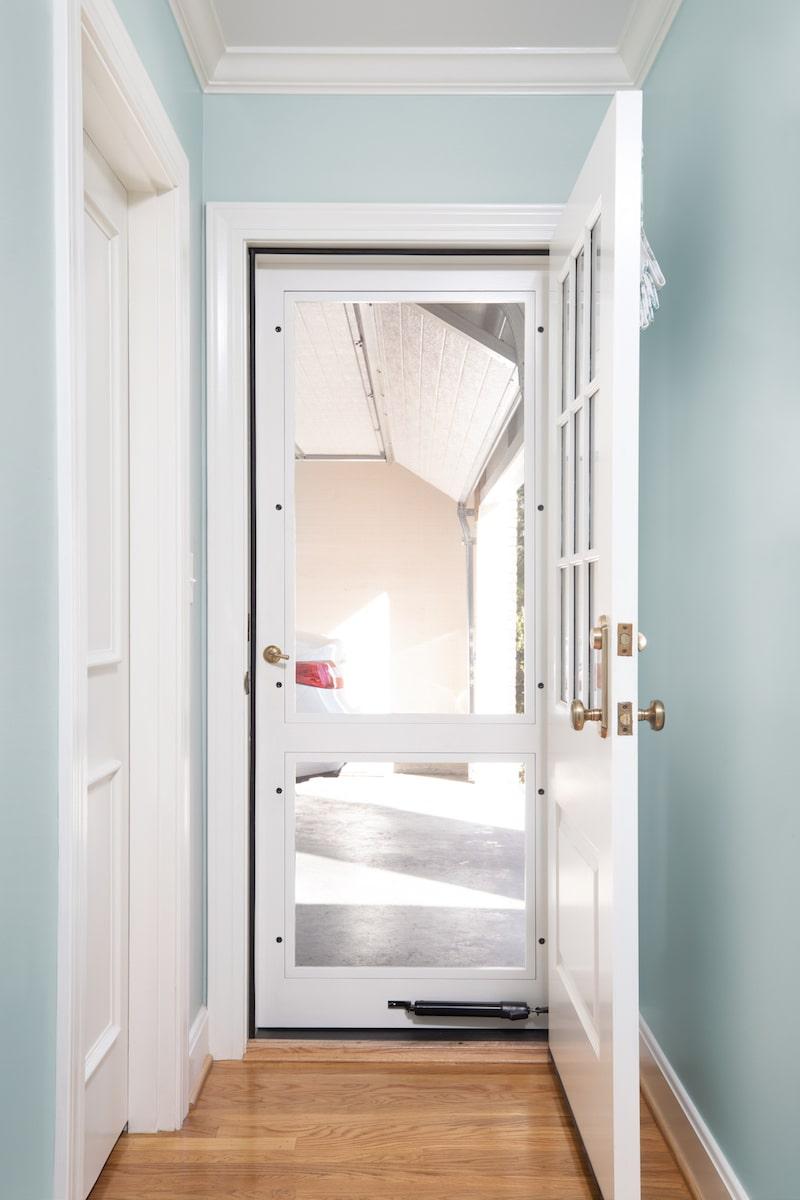 bright storm door in a blue hallway